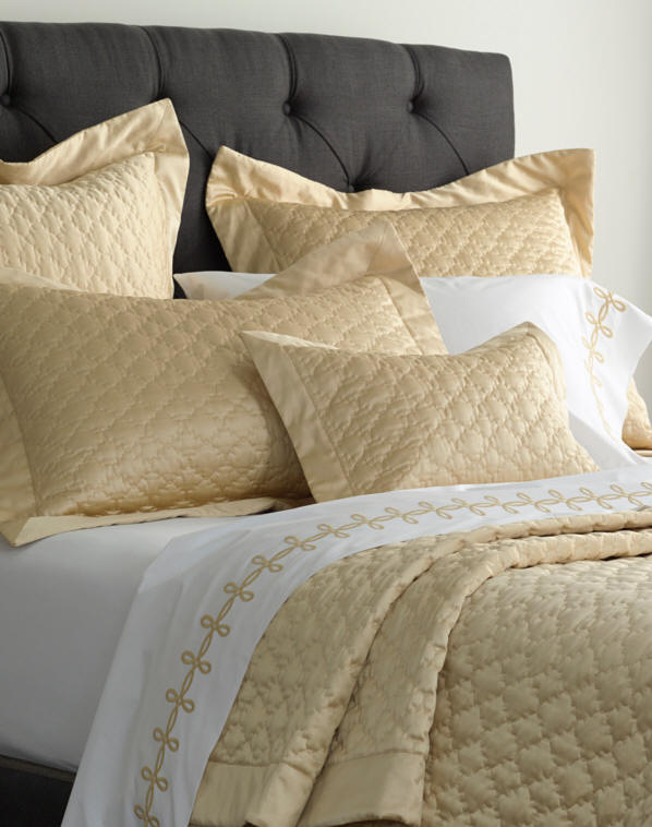 Quatrefoil quilted coverlet and shams