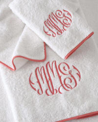 Custom Egyptian Cotton towels finished with a piped border and custom monogram.